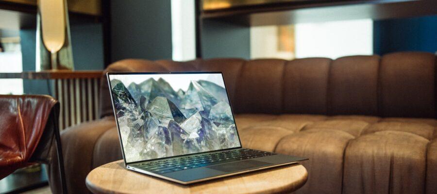 laptop on brown sofa